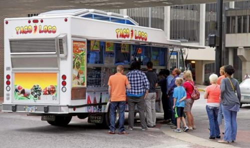 A line outside the Taco Loco food truck at the corner of 5th Avenue and Walnut Street on Friday, June 21, 2013. / Zach Boyden-Holmes/The Register