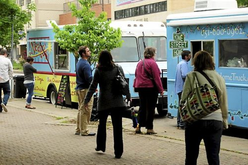 Hungry office workers order food at lunchtime from the Neatos and the Home Street Home food trucks which park on Kellogg Avenue on Thursdays in downtown St. Paul, photographed on Thursday, June 6, 2013. (Pioneer Press: Scott Takushi)