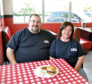 Jim and Tracy Latham opened a Tnt BBQ restaurant in a space they share with fellow food truck operator Lincoln Ogata, of Ogata's Hawaiian Grill.