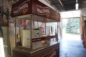 Chameleon Concession owner Mark Palm started in mobile kitchen equipment with hot dog carts. This doughnut cart is an example of one of Palm's finished products.