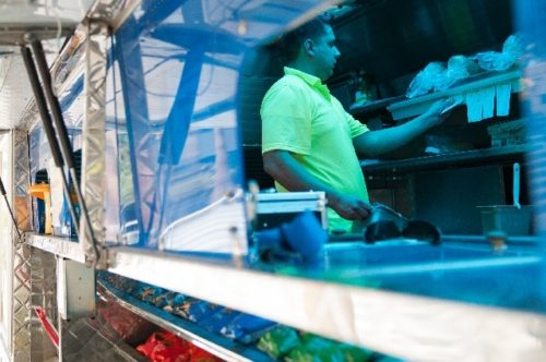 ERIK VERDUZCO/LAS VEGAS REVIEW-JOURNAL Andrew Schoenwetter, owner of Melteez food truck, checks his ticket orders from inside his food truck parked in front of the Regional Justice Center Aug. 6 in Las Vegas, Nev.