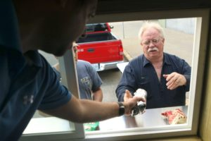 Jessica Stewart | St. Joseph News-Press Lance Taylor, left, serves Rex Strayer lunch Friday morning. Mr. Taylor is a co-owner of The Truck Stop. The food truck recently started serving food throughout St. Joseph.
