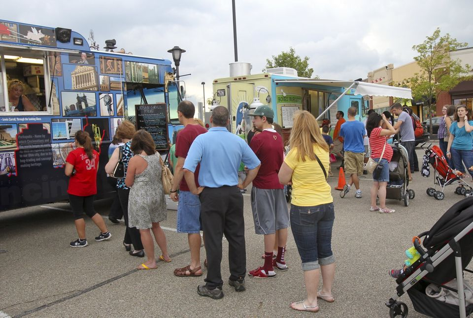 Greg Lynch Crowds line up during the Food Truck Caravan on Aug. 8 at Whole Foods Market in Mason. The Union Centre Food Truck Rally will take place Aug 30 in West Chester Twp. That event will benefit The Boys and Girls Club of West Chester/Liberty.