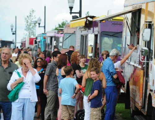 MARKO GEORGIEV/STAFF PHOTOGRAPHER Visitors buy food from a truck at the food truck mash-up in Overpeck County Park in Ridgefield Park, on Wednesday, July 31, 2013.