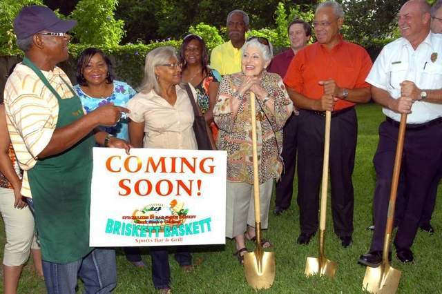Wilfred Kennerson, far left, holds a sign announcing the soon-to-be-opened Briskett Baskett Sports Bar and Grill to be located at 702 N. Market St. On hand for the groundbreaking July 24 were Mayor Donald Cravins, members of the Opelousas-St. Landry Chamber of Commerce and well-wishers from throughout the Opelousas community. / Freddie Herpin, Daily World