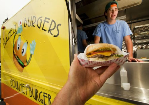 Mainely Burgers attendant Jackson Berman chats with a customer at the lunch wagon in Portland. Carl D. Walsh/Staff Photographer