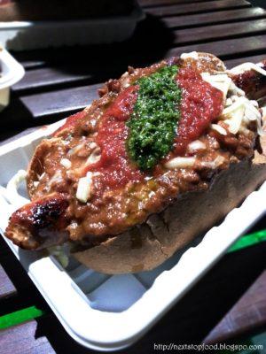 Organic Spelt Bun Chilli Dog  (Chorizo sausage, wagyu chilli con carne, cheese, tomato and chimmichurri) $12