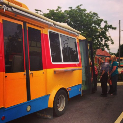 Bill Castro of El Meson in West Carrollton shows K99.1 FM (WHKO) The Breakfast Club host Nancy Wilson the brightly-painted food truck that honors the Castro family's Colombian heritage. (Staff photo by Connie Post)