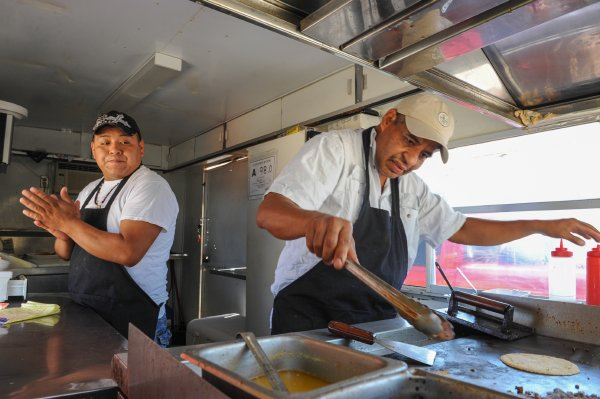Staff photo by Raul R. Rubiera Freddy Rojo Vega, left, handles sales while Jose Guadalupe Arredondo cooks at the Taco Loco food truck on Bragg Boulevard.
