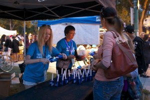 ManyFest volunteers hand out candles for the Parade of Lights. (EDEN RAMSAY PHOTO)
