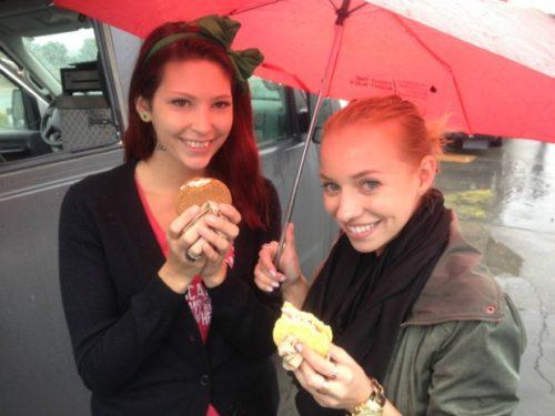 Two girls enjoy ice cream sandwiches at the Taste the Trucks festival. (Neil Herland/CBC)