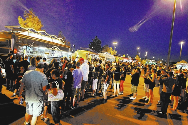 Crowds form lines in front of food trucks at the biannual Las Vegas Foodie Fest in April at the Silverton Casino Hotel. The event returns this weekend.
