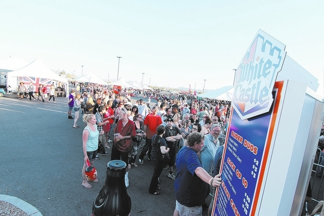 Crowds gather in front of a White Castle food tent at the biannual Las Vegas Foodie Fest in April 2013 at the Silverton, 3333 Blue Diamond Road, in Las Vegas. The average wait time for a White Castle slider was four hours. (Jeff Ragazzo/Special to the Las Vegas Review-Journal)