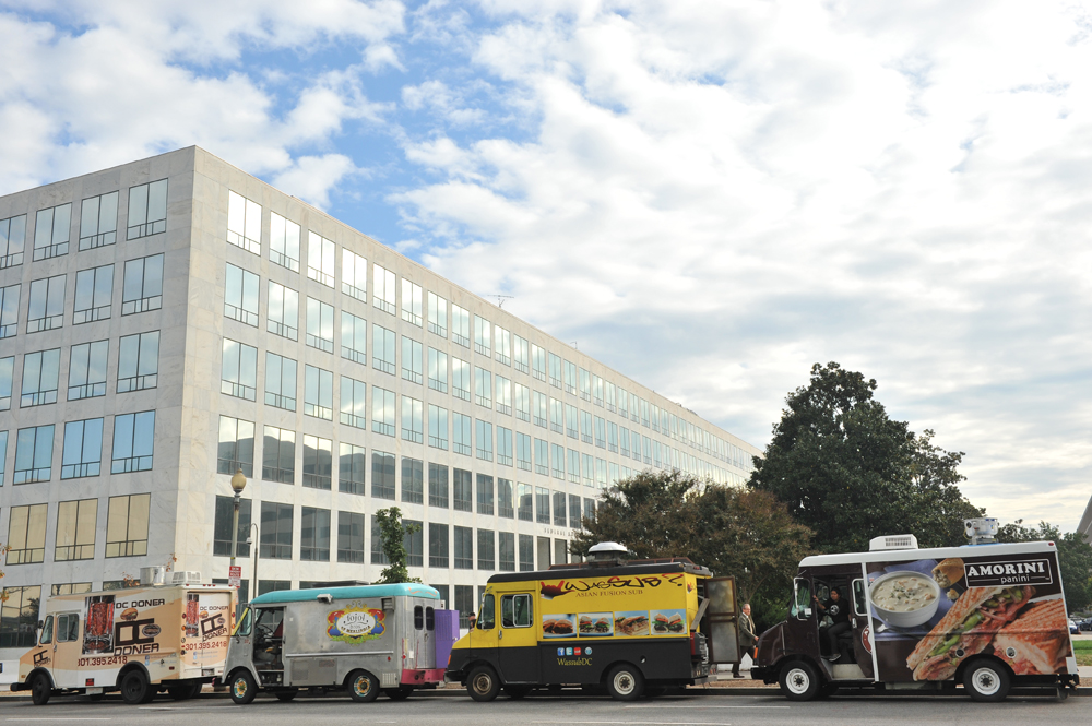 Several food trucks are parked outside the FAA building on D Street SW on Thursday. (Marlon Correa/The Washington Post)