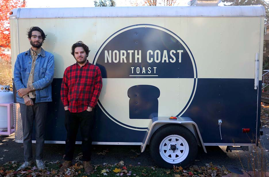 Jeremy Reimnitz, left, and Casey Silverstein, both Oberlin College juniors, stand in front of their food truck, and mobile business, North Coast Toast, on Nov. 9. KRISTIN BAUER/CHRONICLE - See more at: http://chronicle.northcoastnow.com/2013/11/15/oberlin-food-truck-business-hits-road-block/#sthash.DucxHJXG.dpuf