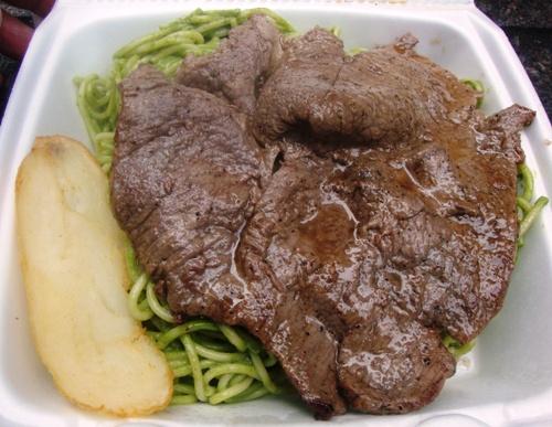 New York, NY: Street Eats – Steak Over Spaghetti Pesto from Manos Peruanos