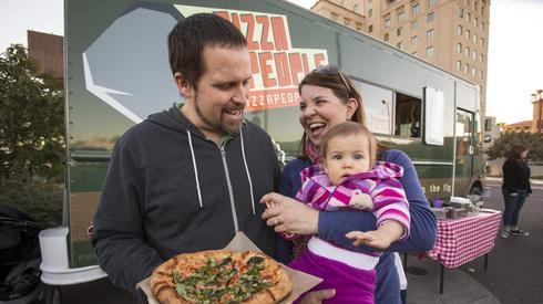 Tim and MaryBeth Scanlon, shown with 10-month-old daughter Stella, debuted their Pizza People food truck in 2011 and then opened a Phoenix restaurant of the same name in September.
