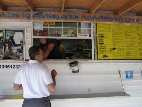 Credit John O'Connor / WUSF A customer orders lunch at Taco Bus on Hillsborough Avenue.