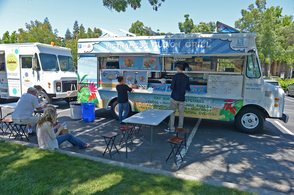 Customers order food from the Vietnamese Fusion Grill food truck during their lunch break at the Shadelands office park in Walnut Creek, Calif., on Friday, July 26, 2013. ((Jose Carlos Fajardo/Bay Area News Group))