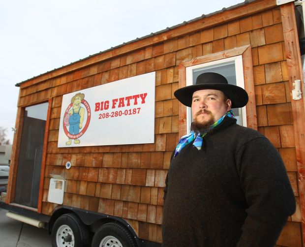 DREW NASH • TIMES-NEWS Owner of Big Fatty's Bar-B-Que Justin Abramowski stands in front of his mobile business Tuesday, Jan. 7, 2014, in Twin Falls.