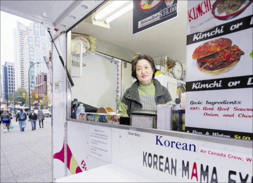 There are more than five dozen food trucks and carts such as the Korean Mama Express located throughout the city of Vancouver. Lee Yong-Sook operates a food cart Korean Mama Express at Georgia and Granville in Vancouver. More than half of the up to $6,000 she makes each month goes toward renting her food cart licence. Photograph by: Gerry Kahrmann, PNG, Vancouver Sun   Photographed by: Gerry Kahrmann, Vancouver Sun