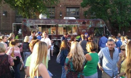 PHOTO BY JILL WENDHOLT SILVA Hungry street diners gather at The Star's Food Truck Friday.