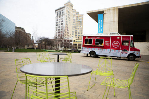 A  Moveable Feast food truck parked on the Wege Plaza next to the Grand Rapids Art Museum un downtown Grand Rapids on Thursday, April 23. The museum expects to host multiple trucks on the plaza on most days through the summer. (Lauren Petracca | MLive)
