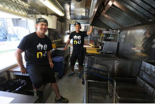 COLIN MCCONNELL / TORONTO STAR Order this photo Bryan Sui-Chong and Allen Tan, left, the two guys behind Me.n.u. which sells Asian food from a food truck. Friday they were at Ribfest in Centennial Park in Etobicoke. Colin McConnell/Toronto Star