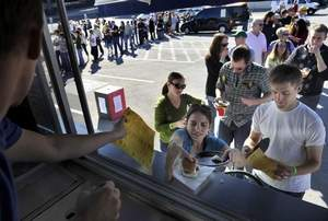 Melissa and Chris Bowles of Nashville try samples from Dallas Shaw of Hoss? Loaded Burgers at the Battle of the Food Trucks. The event helped the Tomorrow Fund. PHOTOS BY JEANNE REASONOVER / THE TENNESSEAN / The Tennessean