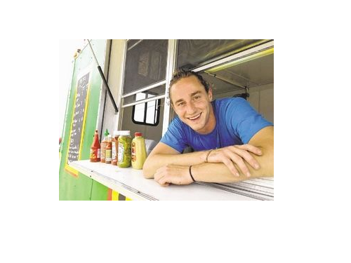Food truck owner Joseph Rugo starts his first day in the business at Baker's Field in Wellfleet, after being turned down by the Cape Cod National Seashore. Seashore officials say they need to study the food truck business and its effects on the park before giving the nod to Rugo or any other vendor.