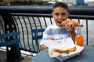 Eric Ruiz, 10, enjoys a hot dog. Cassandra Giraldo for The Wall Street Journal
