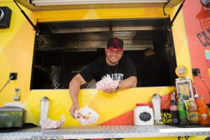 Dan DeMiglio in the window of the food truck. Cassandra Giraldo for The Wall Street Journal