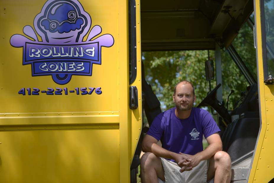 Andrew Russell | Trib Total MediaMike Baughman of Upper Saint Clair and owner/operator of Rolling Cones Ice Cream Truck sits for a portrait at Rock Out All Night, or RANT event at Arsenal Park in Lawreceville, Saturday, Aug. 16, 2014.