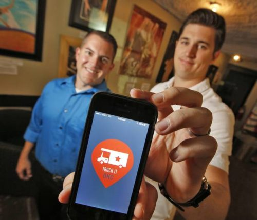 "Truck It Co-Founders Josh DeLozier, left and Travis Stephens in Oklahoma City, Thursday August 21, 2014. ""Truck It"" is a new food truck App. to locate food trucks in the metro area. Photo By Steve Gooch, The Oklahoman"