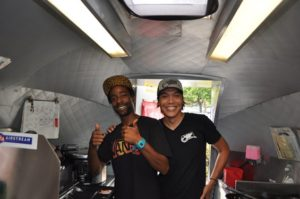 A. Scattergood  Martel McCoy and Tomo Seo inside LuckDish truck
