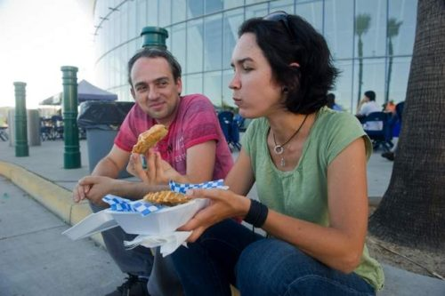 Vera Fishman eats an empanada, while husband Alex Fishman looks on at the Food Truck Frenzy event outside of the Stockton Arena in downtown Stockton. Clifford Oto/The Record