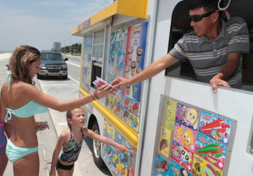 JOHN FITZHUGH/SUN HERALDMinh Nguyen of Gulfport serves ice cream to Paisley Fruge, 14, and Riley Atchison, 6, of Eunice, La., on the Beach in Biloxi. JOHN FTIZHUGH — SUN HERALD |Buy Photo