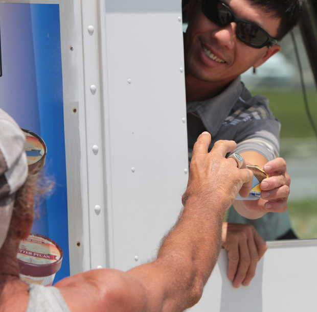 JOHN FITZHUGH/SUN HERALDMinh Nguyen of Gulfport serves ice cream to a customer on the Beach in Biloxi on Thursday, July 31, 2014. JOHN FTIZHUGH — SUN HERALD |Buy Photo