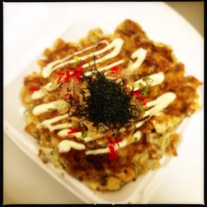 The Okonomiyaki fills an entire Styrofoam container. Photo by Vanessa Wolf