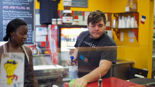 Mariah Pratt looks on as Nicholas Genna wipes the counter at the York Road Sofi's Crepes.  Owner Ann Costlow said last year she supports the idea of making   inspection reports available online, but didn't like the idea of letter grading.  (Karl Merton Ferron / Baltimore Sun)