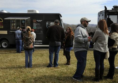 Teens attending a conference at Hope Park Community Church line up outside the Electric Sliders food truck and others to buy lunch last month in Nashville. (Photo: George Walker IV / The Tennessean)