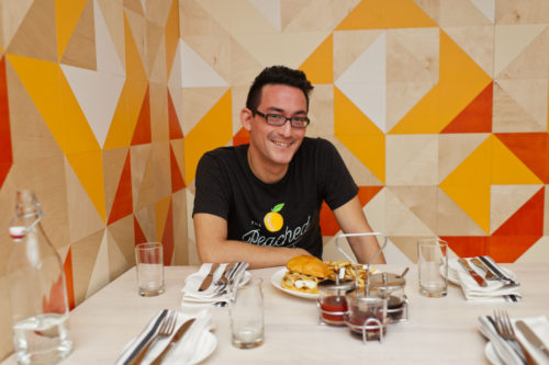 Founder Eric Silverstein within the walls of The Peached Tortilla brick and mortar (Credit: Inked Fingers)