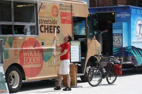 """Gary Matthews of the Whole Foods Food Truck enjoys working at Harvard in particular: """"I've found that students here make informed nutritional choices, which allows us to continually update our menu in interesting and health-conscious ways."""" MICHELLE M. NG"""