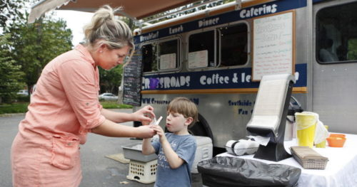 Alexa Welch Edlund/Times-Dispatch  Crossroads Coffee and Ice Cream drew fans at the Food Truck Court at the Virginia Historical Society in May. For many, the trucks are a step toward opening a store.