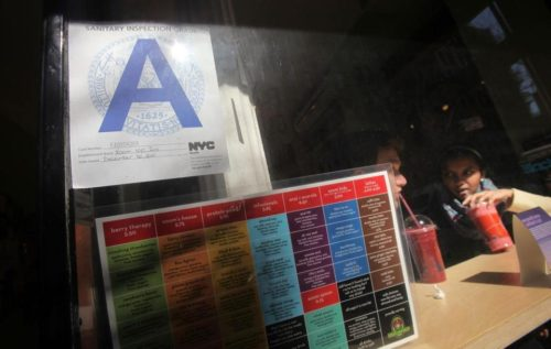 MARIO TAMA/GETTY IMAGES Boston may create a restaurant rating system that resembles New York's prominently posted letter grades for establishments.