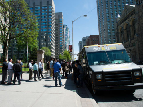 A line-up forms at Me.n.u Food Truck on Bloor St. Thursday — Toronto's first day under looser food truck regulations, approved by City Council last week. Tyler Anderson / National Post