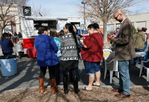 Customers wait in line during the first Food Truck Friday in Pasco on March 6. The event has been so popular more vendors are needed to meet demand.  ANDREW JANSEN — Tri-City Herald