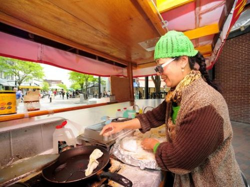 Hong Yo of Burlington, owner of Hong's Chinese Dumpling cart, sells her delicacies on the Church Street Marketplace in Burlington in 2009. Hong's will be part of Food Cart Wednesdays on the Marketplace starting this week. (Photo: Burlington Free Press)