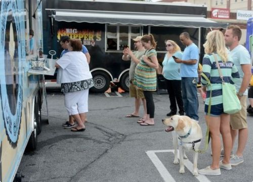 People check out what's available Sunday during the Food Truck Festival at the VF Outlet Center in Wyomissing