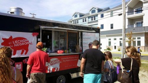 Plenty of variety was offered during Sea Isle City's first-ever Food Truck Festival last September. Here, people wait outside of El Lechon de Negron, a food truck specializing in authentic Puerto Rican roast pork. The festival was such a success that the event coordinators decided to create a second Sea Isle City food truck event (Sea Isle City Food Truck Rally), which will take place from Friday, June 26 to Sunday, June 28, 2015. (Special to the Times | Denis Brown, Stallion Marketing LLC)
